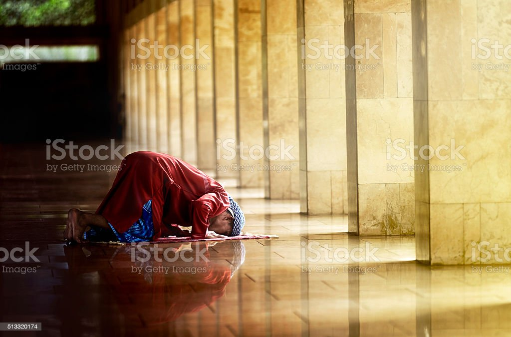 Religious muslim man praying stock photo