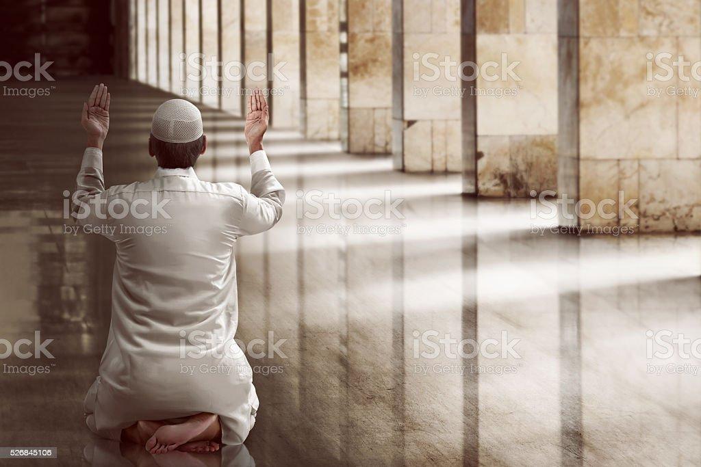 Religious muslim man praying stock photo