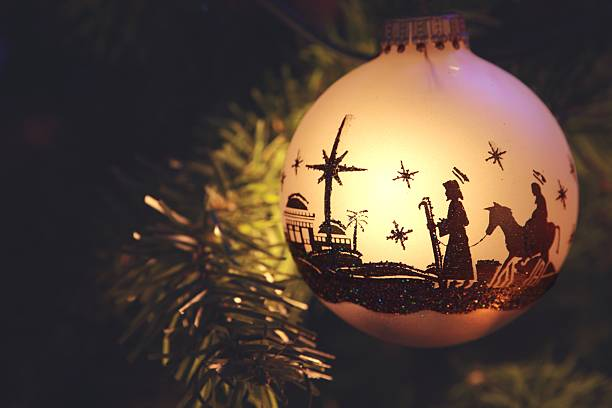 religious: nativity scene silhouette on christmas ornament - nativity scene stock pictures, royalty-free photos & images