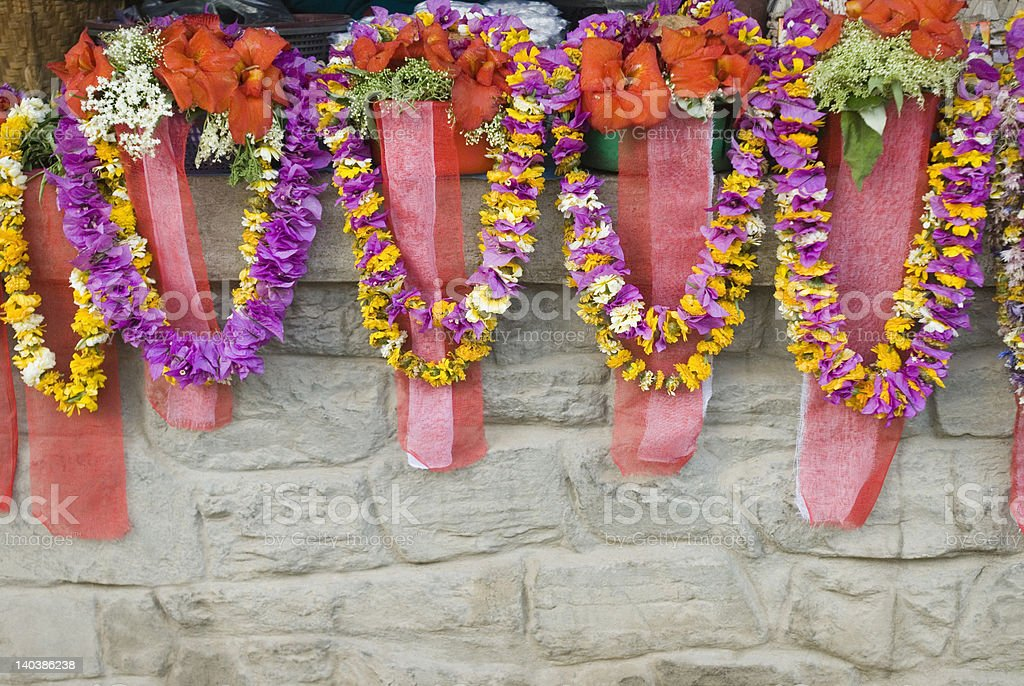 Religious offerings and garlands on a temple wall, Katmandu, Nepal royalty-free stock photo