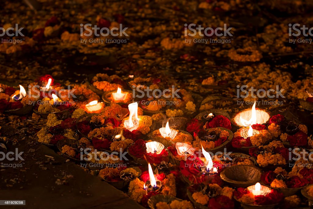 Religious offerings on River ganges and oil lamps, Varanasi, India stock photo