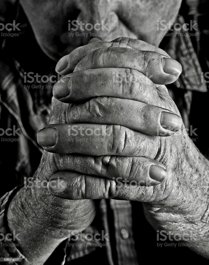 Religious: Old Man Praying Hands stock photo