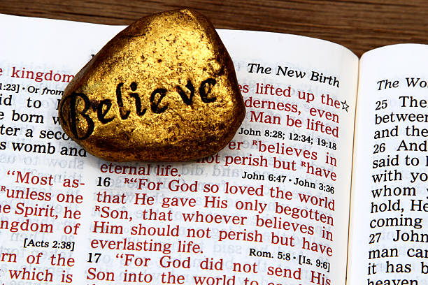 religious: open bible scripture of john 3:16 with believe stone - number 16 stock photos and pictures