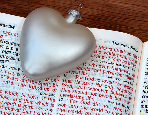 religious: open bible scripture of john 3:16 with white heart - number 16 stock photos and pictures