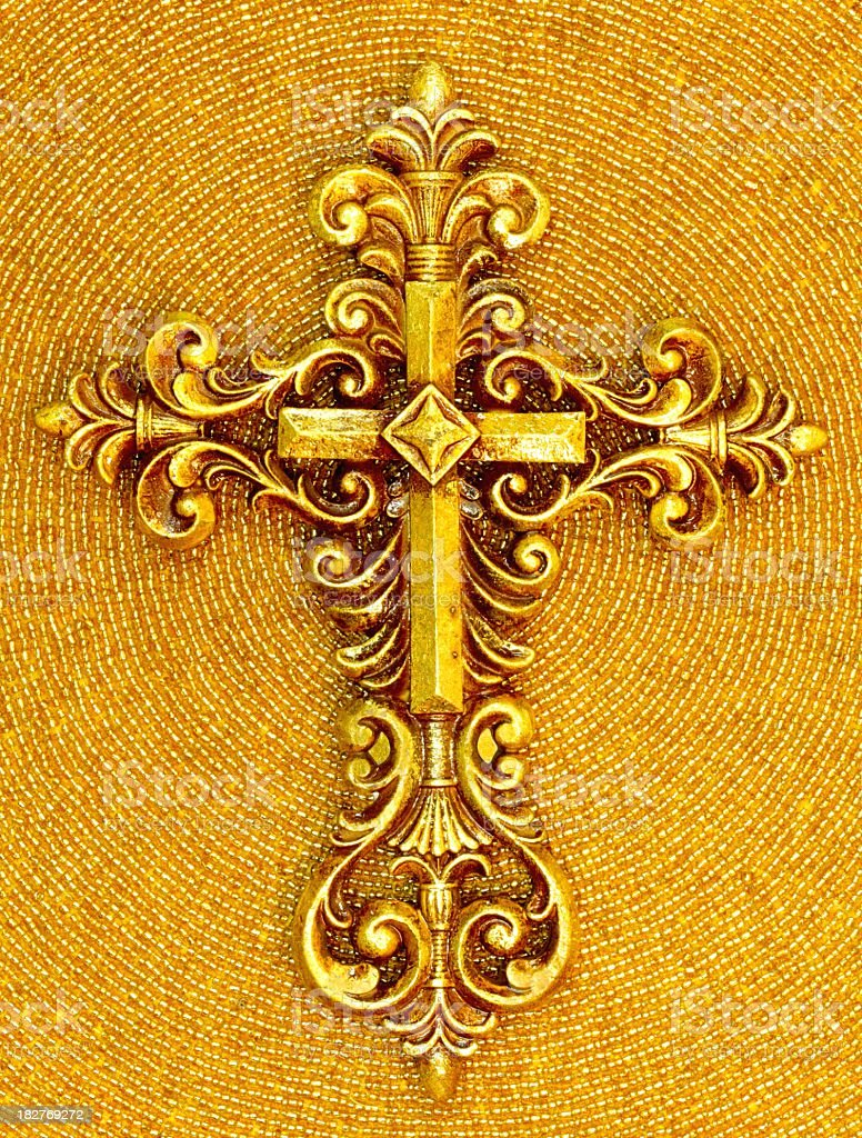 Religious: Ornate Gold Cross on Beaded Background royalty-free stock photo