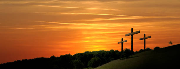 Religious representation with three crosses and nature landscape background stock photo
