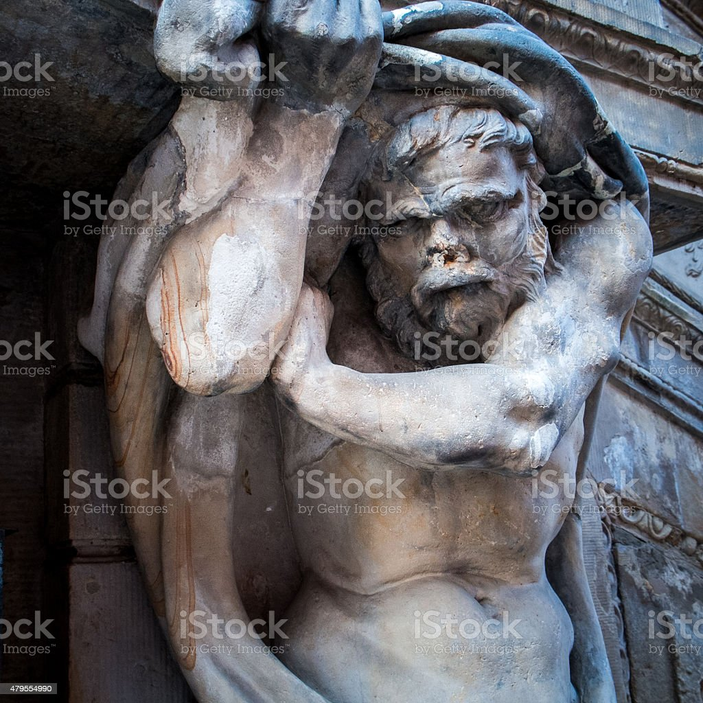Religious sculpture on facade of old wall in Gdansk, Poland stock photo