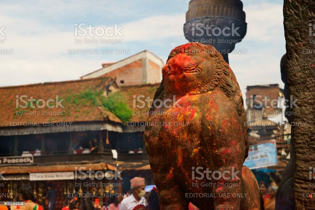 religious statue of lion with colored powder at Bhaktapur temple stock photo
