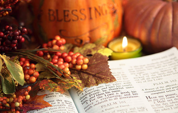 Religious: Thanksgiving Bible Scripture with pumpkin and berries stock photo