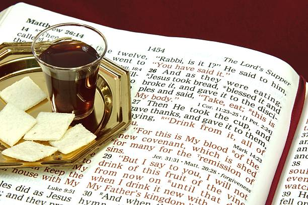 religious: the lord's supper with open bible - communion stock pictures, royalty-free photos & images