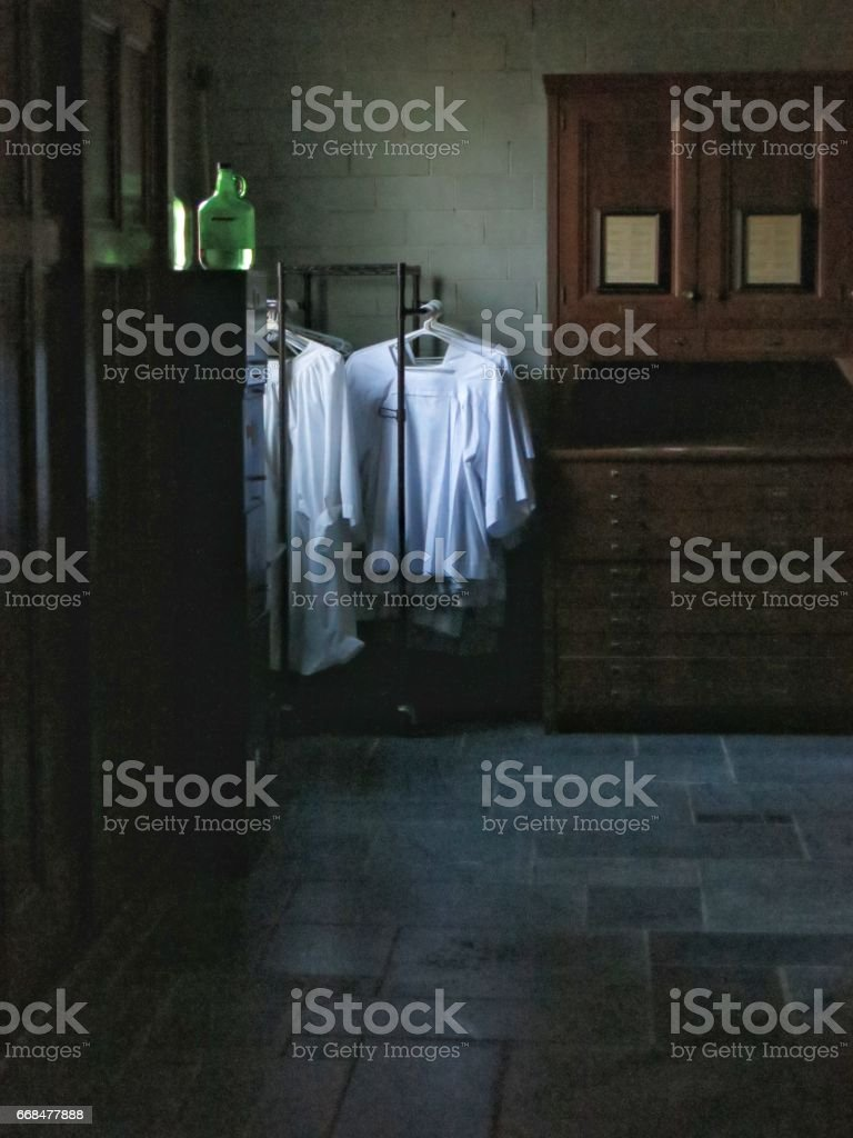 Religious Vestments Hanging in Church, Evening Light stock photo