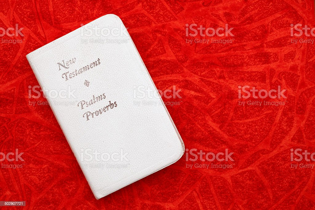 Religious: white Holy Bible on Red Background royalty-free stock photo