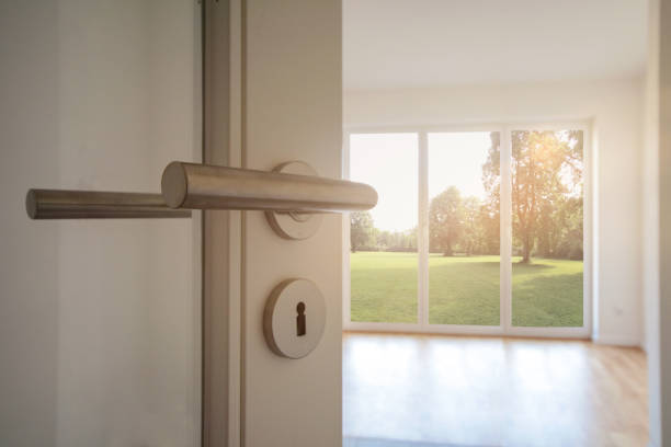 Relocation, Moving to new apartment - Door to modern living room with view to garden Relocation, Moving to new apartment - Door to modern living room with view to garden front door stock pictures, royalty-free photos & images