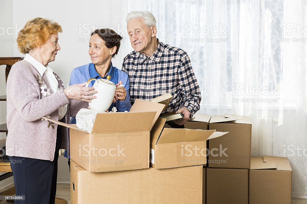 Relocation: Senior adult moving house stock photo