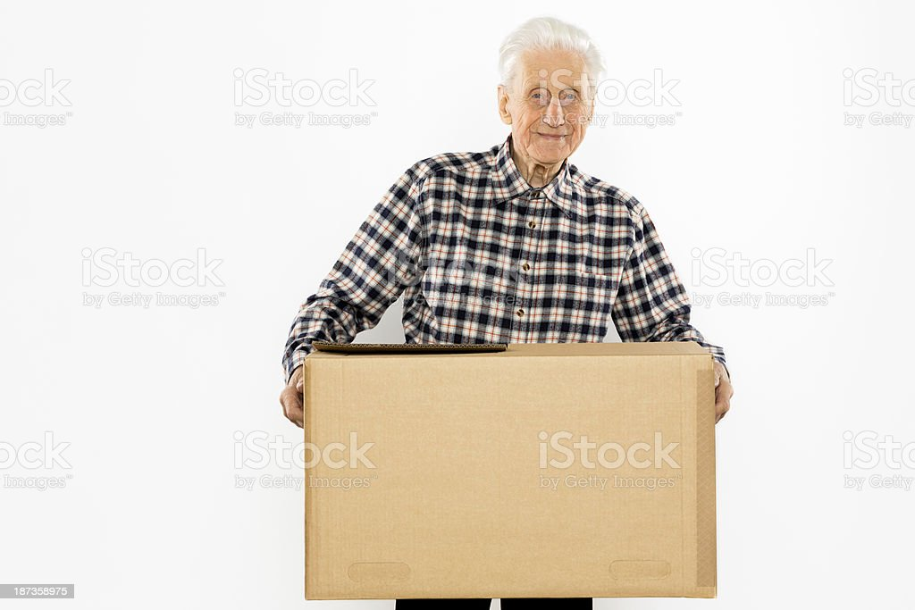 Relocation: Senior adult moving house royalty-free stock photo