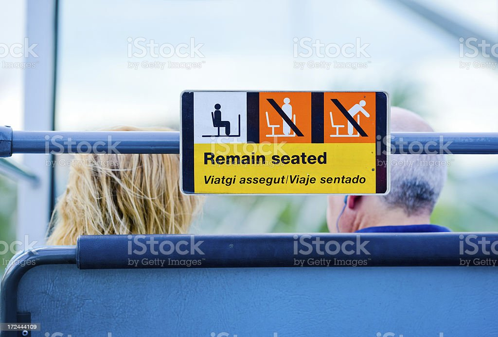 Remain seated sign in tour bus, Barcelona royalty-free stock photo