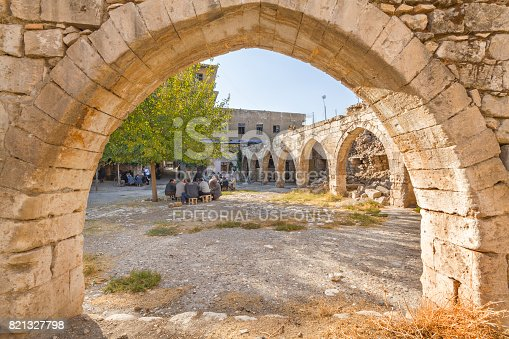 istock Remains of a caravansary and local men, in Adiyaman, Turkey. 821327798