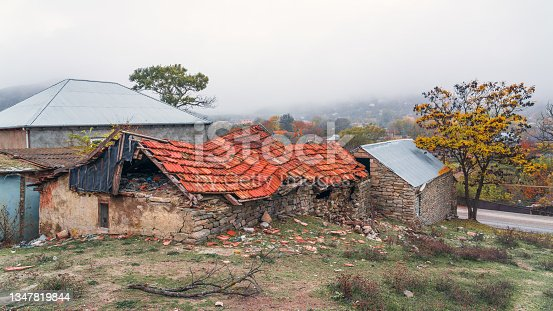 istock Remains of an old ruined stone house 1347819844