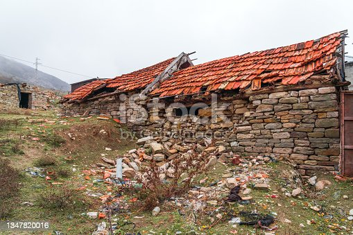 istock Remains of an old ruined stone house 1347820016