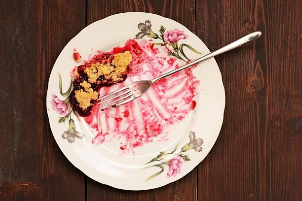 remains of delicious cherry pie in white plate - tallrik uppätet bildbanksfoton och bilder