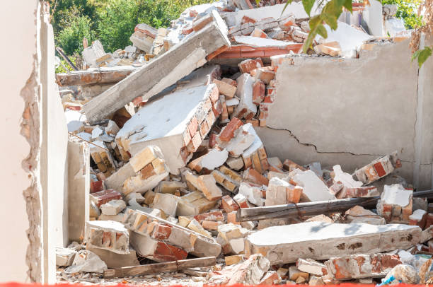 Remains of hurricane or earthquake disaster damage on ruined old house with collapsed roof and walls on the pile Remains of hurricane or earthquake disaster damage on ruined old house with collapsed roof and walls on the pile collapsing stock pictures, royalty-free photos & images