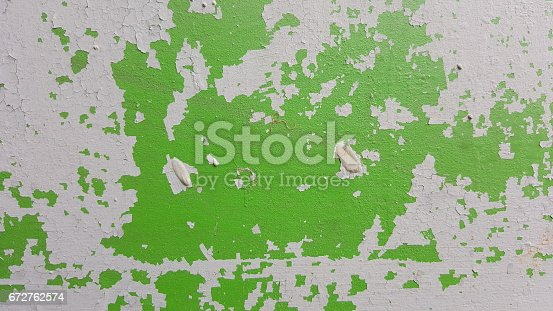 629255068 istock photo Remains of old paint on the painted surface 672762574