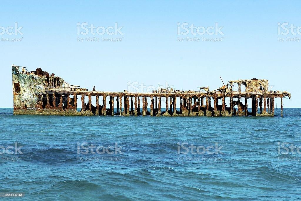 Remains of sunken ship in Bimini Island stock photo