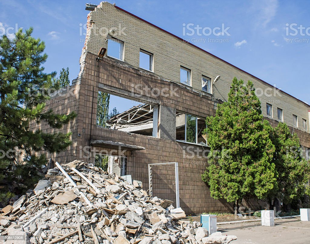 Remains of the destroyed building in Donetsk stock photo