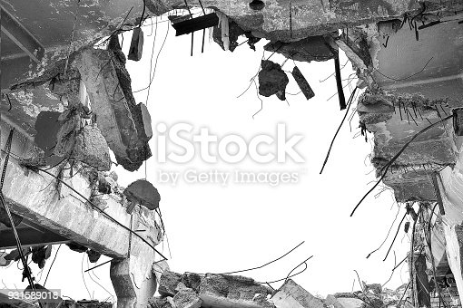 Remains of the destroyed industrial building. Black-and-white image