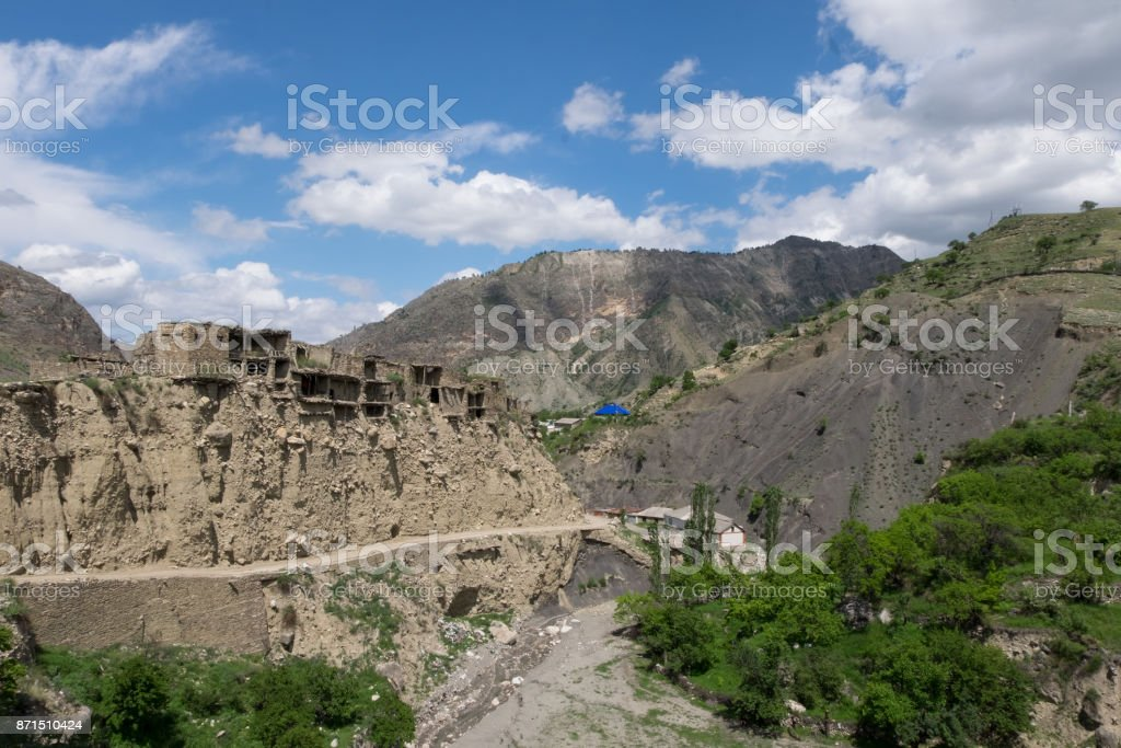 remains of the old settlement in the mountains, destroyed houses stock photo
