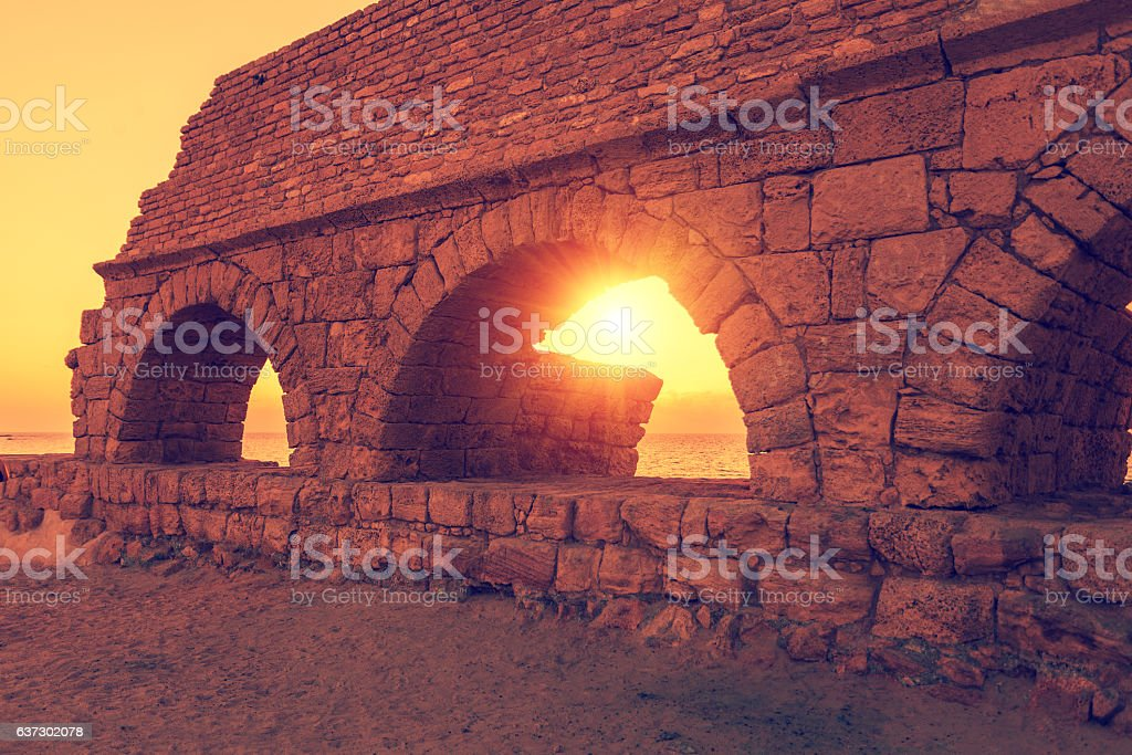 Remains of the Roman aqueduct in ancient city Caesarea stock photo