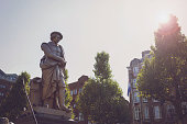 Amsterdam, Netherlands - July 12, 2012: Statue Of Rembrandt at Rembrandtplein, a major square in central Amsterdam, the Netherlands, named after the famous painter Rembrandt who owned a house nearby.