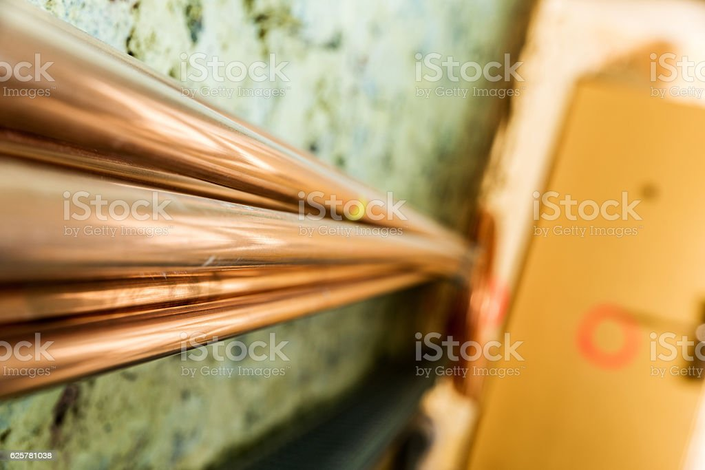 Remediation of brick wall and pipes stock photo