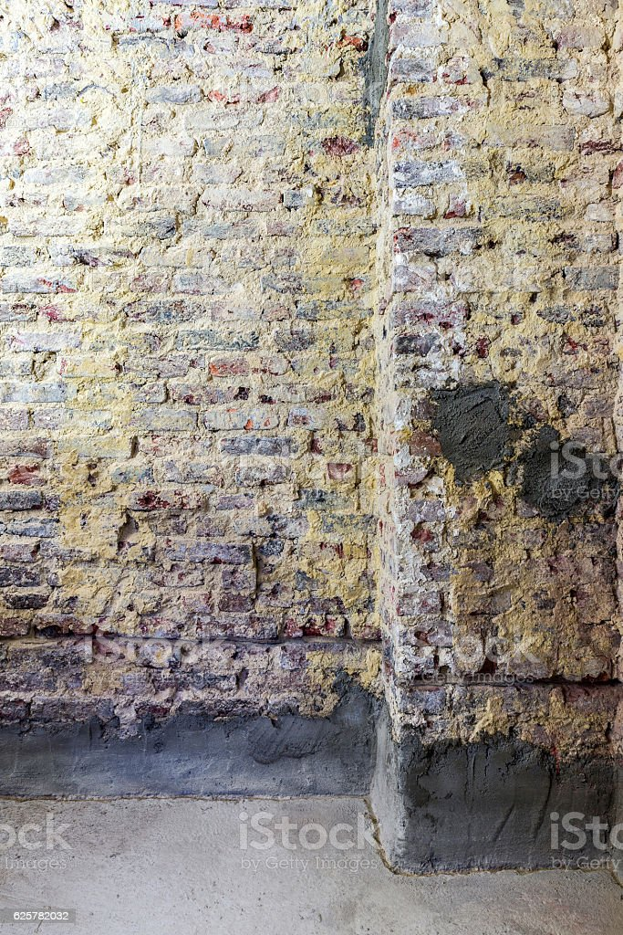 Remediation of brick wall stock photo