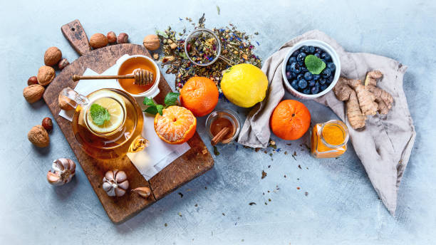 Remedies for cold and flu.Healthy food immune boosting selection. Remedies for cold and flu.Healthy food immune boosting selection.  Foods high in antioxidants, minerals and vitamins. Antiviral treatment antiviral drug stock pictures, royalty-free photos & images