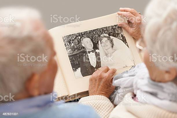 Shot of a senior couple leafing through their wedding albumhttp://195.154.178.81/DATA/shoots/ic_783134.jpg