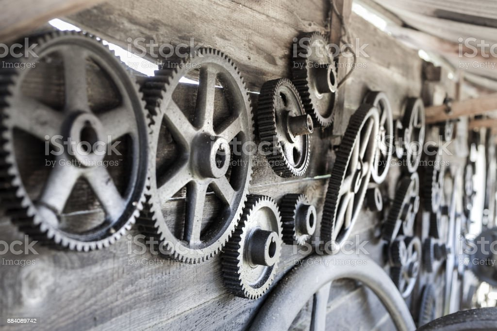 Remember the past: old gearwheels in Romania, Csernat, transylvania stock photo