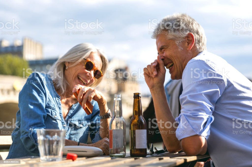 Remembering our great experiences - Seniors having fun drinking stock photo