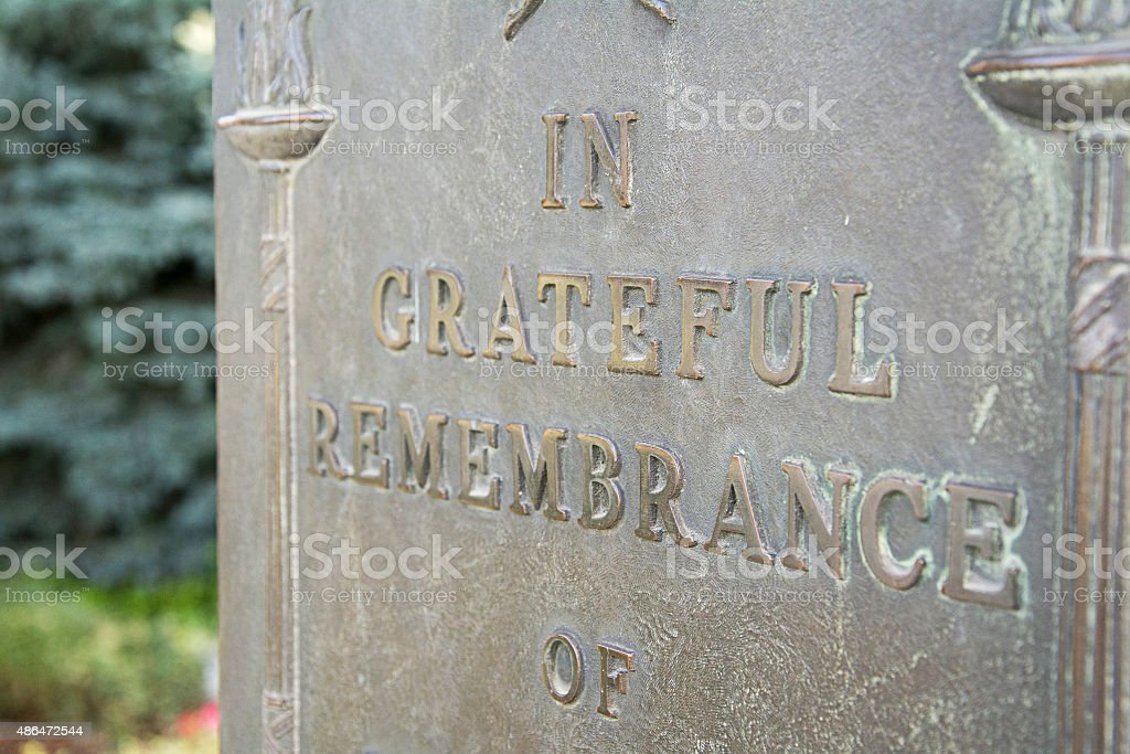 remembrance stone for war hero stock photo