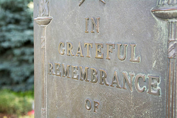 remembrance stone for war hero - memorial day weekend stock pictures, royalty-free photos & images