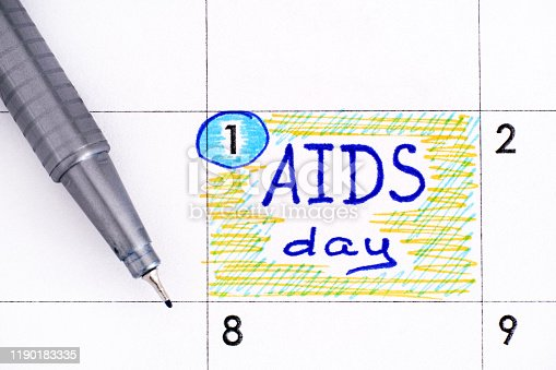 istock Reminder AIDS Day in calendar with blue pen. 1190183335