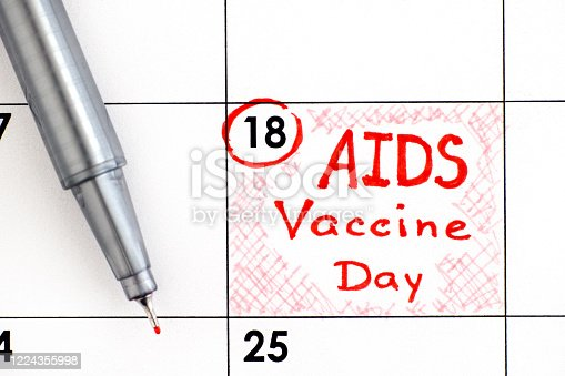 istock Reminder AIDS Vaccine Day in calendar with pen. May 18. 1224355998