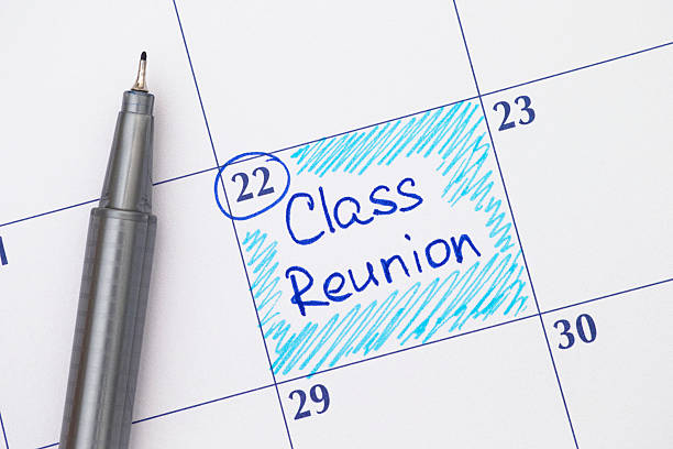 reminder class reunion in calendar with pen - reunion stock photos and pictures