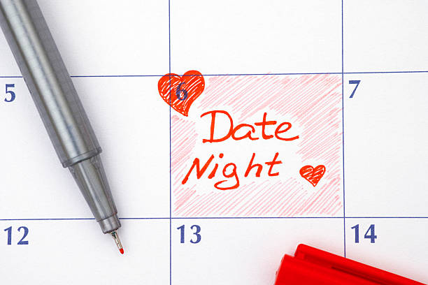 Reminder Date Night in calendar Reminder Date Night in calendar with red pen date night romance stock pictures, royalty-free photos & images