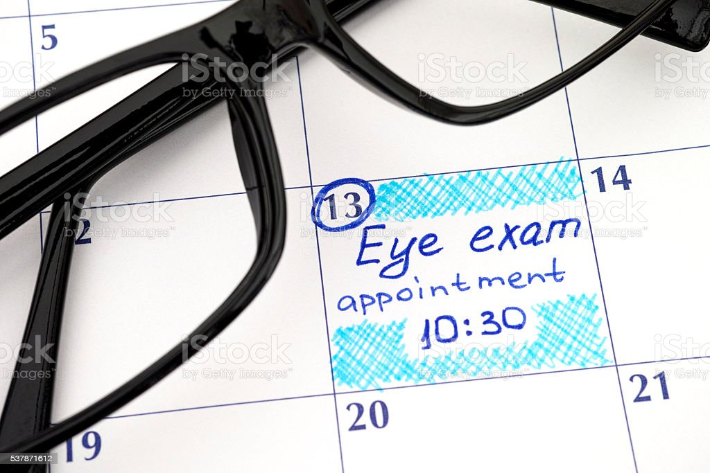 Reminder Eye exam appointment in calendar with glasses stock photo