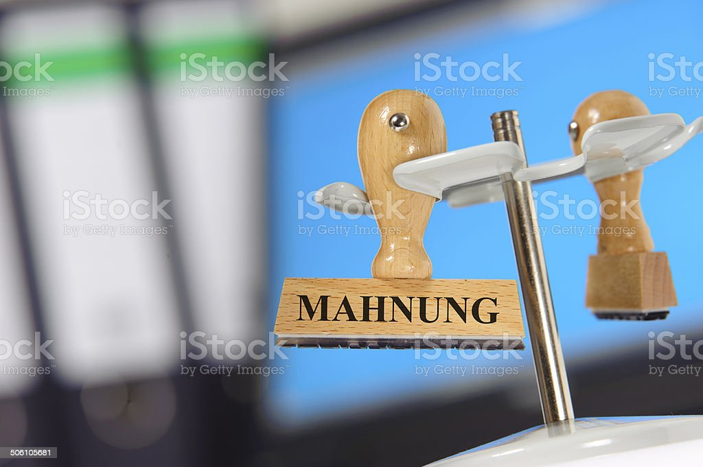 reminder - in german: Mahnung stock photo