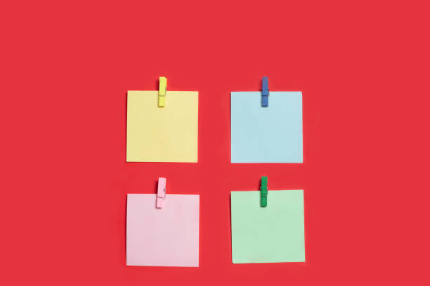 Reminder multicolored stickers on a red background stock photo