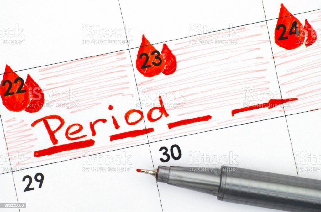 Reminder Period in calendar with red pen. stock photo