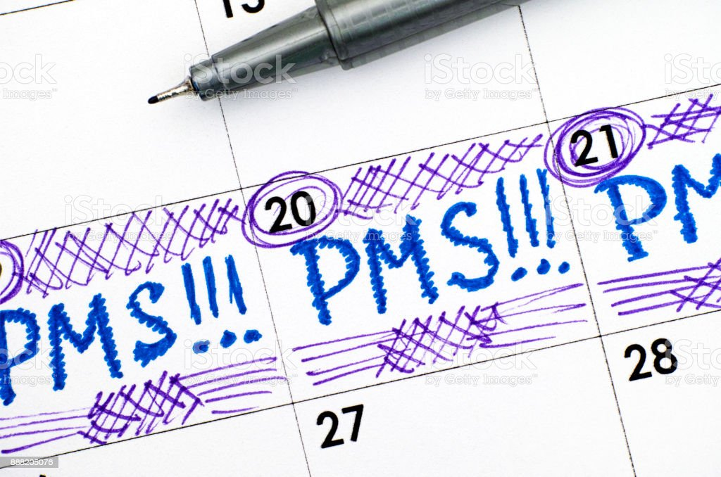 Reminder PMS in calendar with pen. stock photo