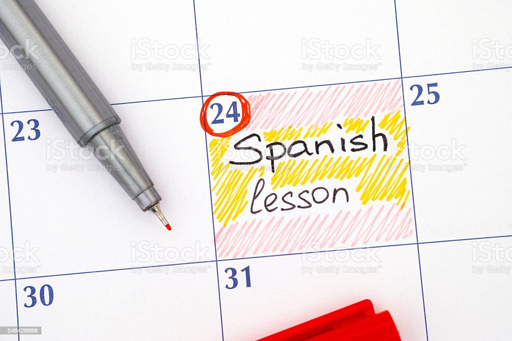 Reminder Spanish Lesson In Calendar With Pen Stock Photo - Download